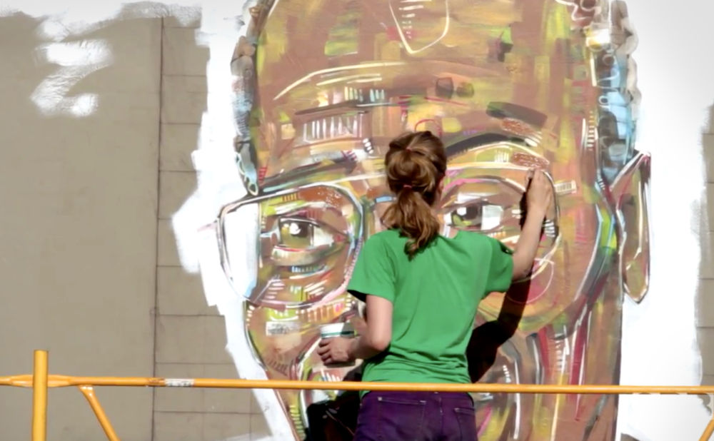 Gwenn Seemel working on the Kirk Reeves mural