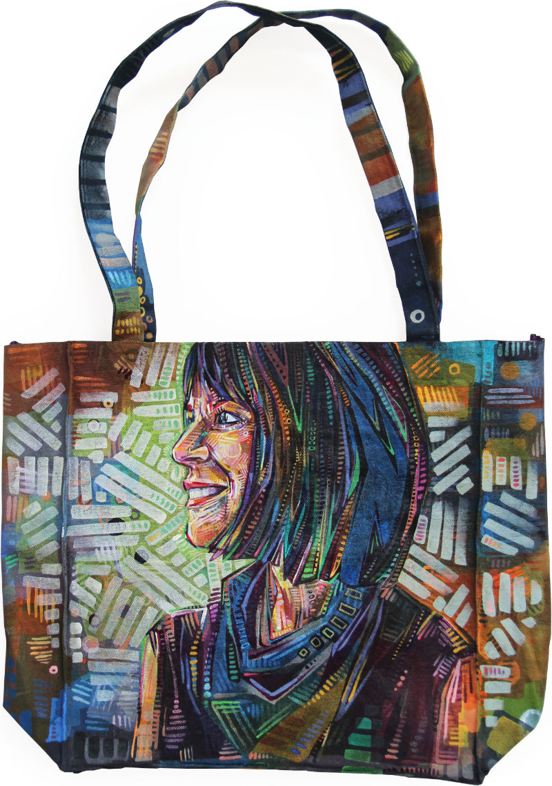 profile of a white woman with black hair painted on a canvas tote