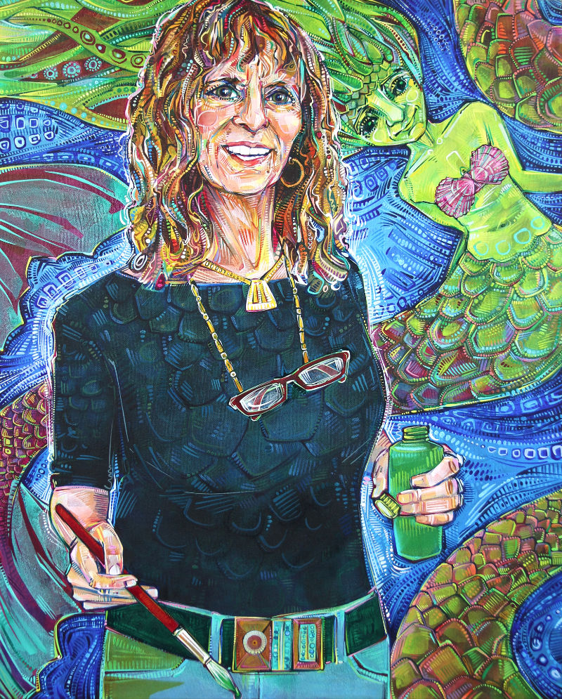 a white woman holding a paint brush and a bottle of paint with mermaids swimming behind her, painted in bright colors and bold strokes