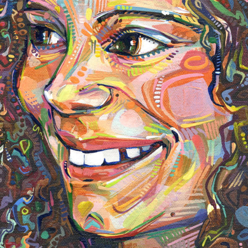 portrait of a smiling girl with curly hair