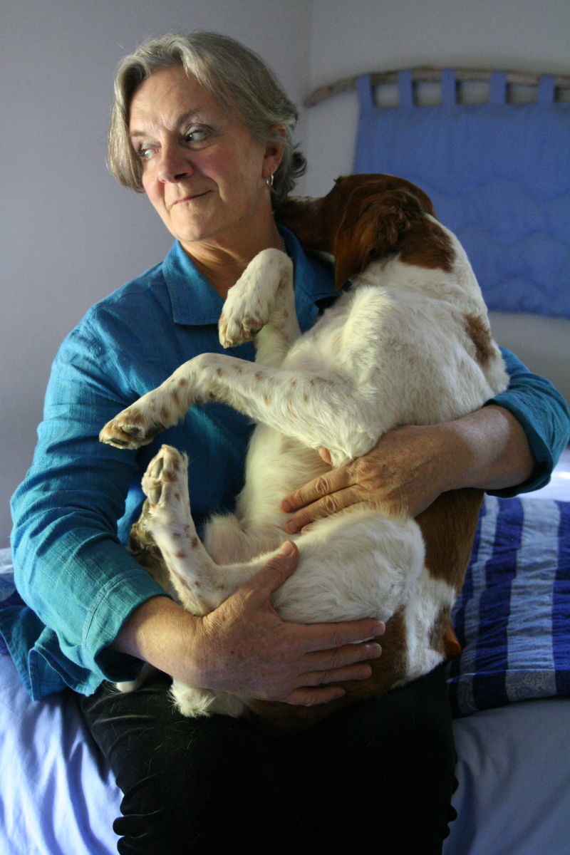 dog cradled in a woman's arms